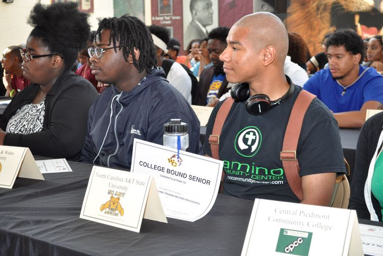 """Nathene Stowe, third from left, a 2016 graduating senior at West Charlotte High School, sits with classmates at a """"Decision Day"""" ceremony acknowledging those who will go on to college or join the U.S. military. Stowe will attend North Carolina A&T State University in the fall. Photo: Glenn H. Burkins"""