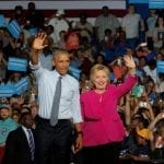 Obama in Charlotte, says ready to 'pass baton' to Clinton