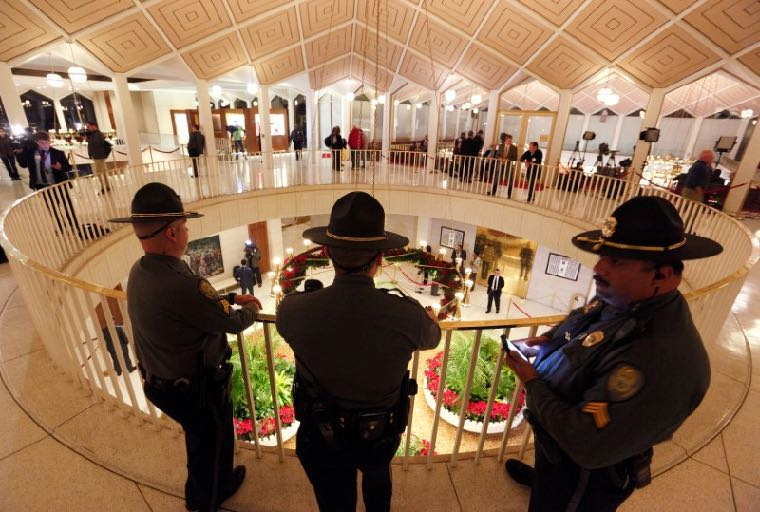 North Carolina State Highway troopers keep watch in the rotunda of the Legislative Building as lawmakers negotiate over repealing the controversial HB 2 law limiting bathroom access for transgender people in Raleigh, North Carolina, U.S. December 21, 2016. REUTERS/Jonathan Drake