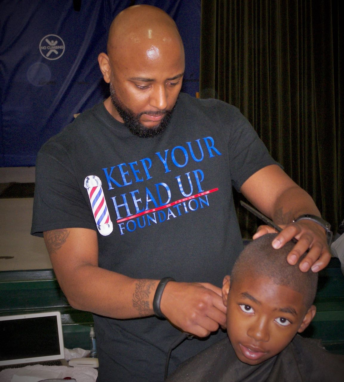 Barbers give free cuts at high poverty schools   Q City Metro