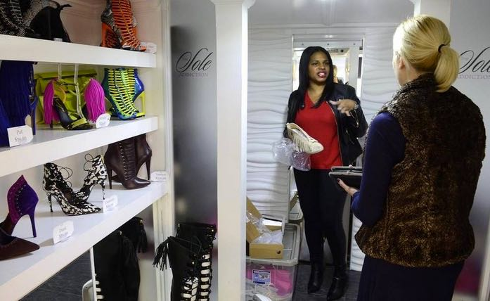 Robinson had at least one customer, Monique Prato (on right), who bought a pair of Lambert suede fringed booties on Friday Dec. 4, 2015. (Photo: John D. Simmons, The Charlotte Observer)