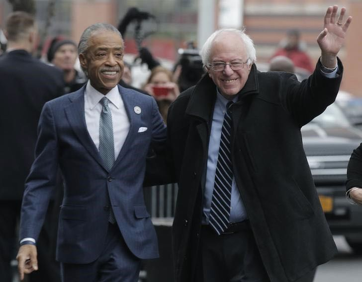 Democratic U.S. presidential candidate Bernie Sanders (R) is greeted by the Rev. Al Sharpton after Sanders arrived for a meeting at Sylvia's Restaurant in the Harlem section of New York February 10, 2016. REUTERS/Brendan McDermid