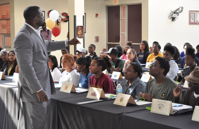 The Rev. Jacotron Potts, an associate minister at The Park Church, offers words of encouragement to graduating seniors at West Charlotte High School.