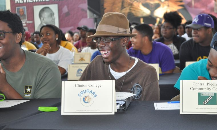 Tyvonne Reid, center, will attend Clinton College in the fall.