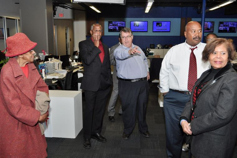 WBTV (Channel 3) News Director Dennis Milligan, center, leads a tour of the newsroom for about a dozen members of First Baptist Church-West, who stopped by the station to honor veteran reporter Steve Crump, who marked 30 years at WBTV, December 21, 2016. (Photo: Glenn Burkins for Qcitymetro)