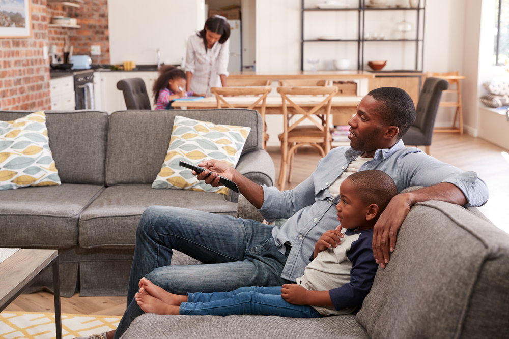 Black-news-family-watching-TV